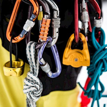 Close up view of ropes and climbing gear.