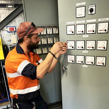 Man adjusting meter.