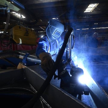 Person welding with mask on.