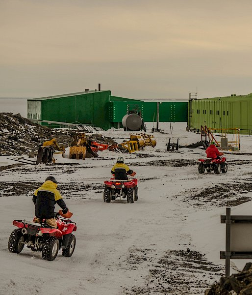 Expeditioners driving quad bikes back to station